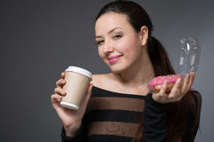 Woman with a paper cup of coffee Royalty Free Stock Photography