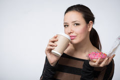 Woman with a paper cup of coffee Stock Image