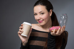 Woman with a paper cup of coffee Stock Photos