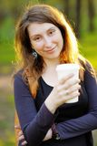 Woman with paper cup of coffee Stock Photo