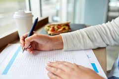 Woman with paper form having lunch at cafe Royalty Free Stock Photos