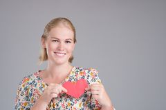 Woman with paper heart Stock Photos
