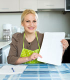 Woman with paper at home Royalty Free Stock Image