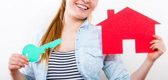Woman and paper house. Housing real estate concept Stock Photos