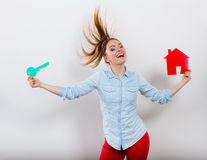 Woman and paper house. Housing real estate concept Royalty Free Stock Photos