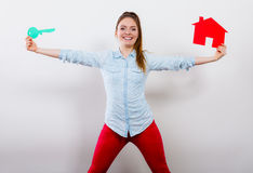 Woman and paper house. Housing real estate concept Stock Image