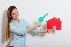 Woman and paper house. Housing real estate concept Stock Images