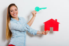 Woman and paper house. Housing real estate concept Royalty Free Stock Photo