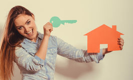 Woman and paper house. Housing real estate concept Stock Photography