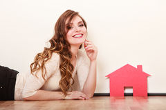 Woman paper house. Housing real estate concept Stock Photos