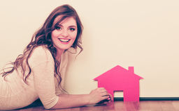 Woman paper house. Housing real estate concept Stock Photography