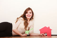 Woman paper house. Housing real estate concept Royalty Free Stock Photos