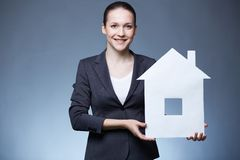 Woman with paper house Stock Images