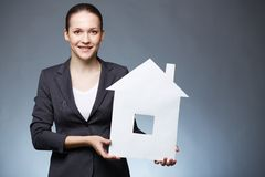 Woman with paper house Stock Image