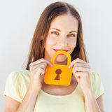 Woman with the paper lock. Funny portrait of a woman keeping silence with the paper lock over her mouth Stock Image