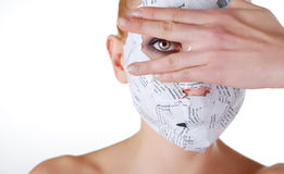 Woman in paper mask. Looking through the fingers Royalty Free Stock Photo