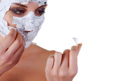 Woman in paper mask. Face of a young woman in paper mask Royalty Free Stock Images