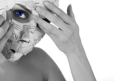 Woman in paper mask. Face of a young woman in paper mask Stock Photo