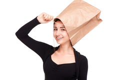 Woman with paper packet on head Stock Image