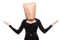 Woman with paper packet on head Royalty Free Stock Images