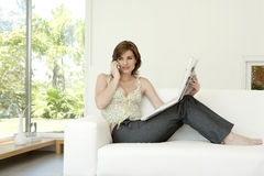 Woman with Paper on Phone Stock Photography
