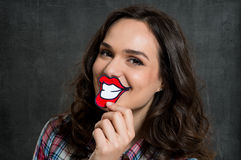 Woman With Paper Smile. Young Woman Holding Fake Paper Smile In Front Of Lips Stock Image