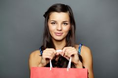 Woman with paperbag Stock Images
