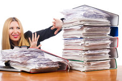 Woman with  papers. Woman with pile of papers Stock Photography