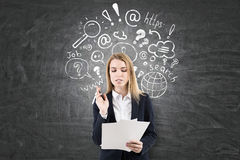 Woman with papers, internet search on chalkboard Royalty Free Stock Photos
