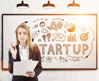 Woman with papers and startup icons, whiteboard Royalty Free Stock Photo