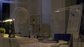 Woman with papers working at night office stock footage