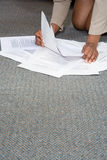 Woman with paperwork on the floor Stock Photos