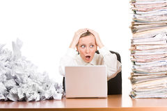 Woman with paperwork stacked up Stock Photography
