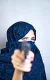 Woman paranzhe shoots a gun Stock Images