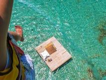 Woman parasailing Stock Photography