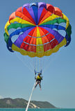 Woman parasailing over aqua water Royalty Free Stock Image
