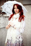Woman with parasol. Young woman in elgant summer clothes with parasol, outdoor shot Stock Photography