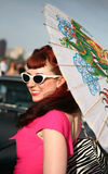 Woman with parasol in 1950's style. A woman dressed as Rockabilly, the hip culture of the 1950s style, and holding a decorative parasol Royalty Free Stock Photo