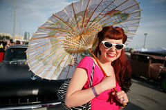 Woman with parasol in 1950's style Royalty Free Stock Image
