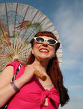 Woman with parasol in 1950's style. A woman dressed as Rockabilly, the hip culture of the 1950s style, and holding a decorative parasol Royalty Free Stock Photos