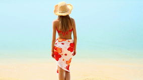 Woman in pareo and bikini at tropical beach Royalty Free Stock Image