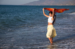 A woman with the pareo is on a coast Stock Photo