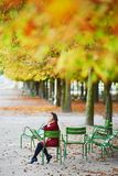 Woman in Paris on a bright fall day Stock Photos