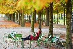 Woman in Paris on a bright fall day Royalty Free Stock Photography