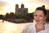 Woman in Paris. Portrait of the woman in Paris with Norte dame view behind her Royalty Free Stock Image