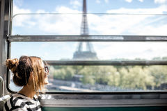 Woman in Paris subway train. Young woman looking on the Eiffel tower through the train window in Paris Stock Photography