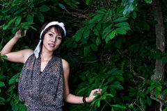 Woman in park. A beautiful asian woman is in the tropical park Stock Images