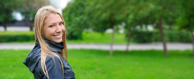 Woman in park. Young happy woman in park. panoramic view Stock Photo