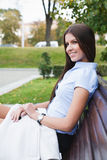 Woman in park. Portrait a beautiful caucasian woman  in the park Royalty Free Stock Image