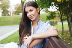 Woman in park. Portrait a beautiful caucasian woman  in the park Royalty Free Stock Photo